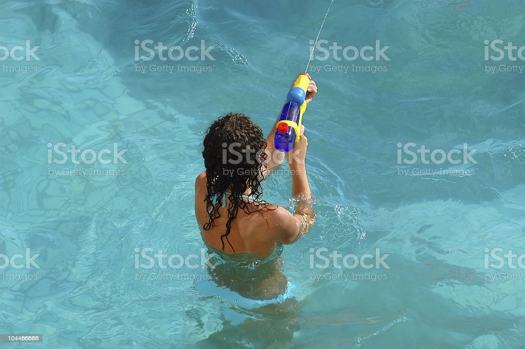The girl plays with a children's toy stock photo