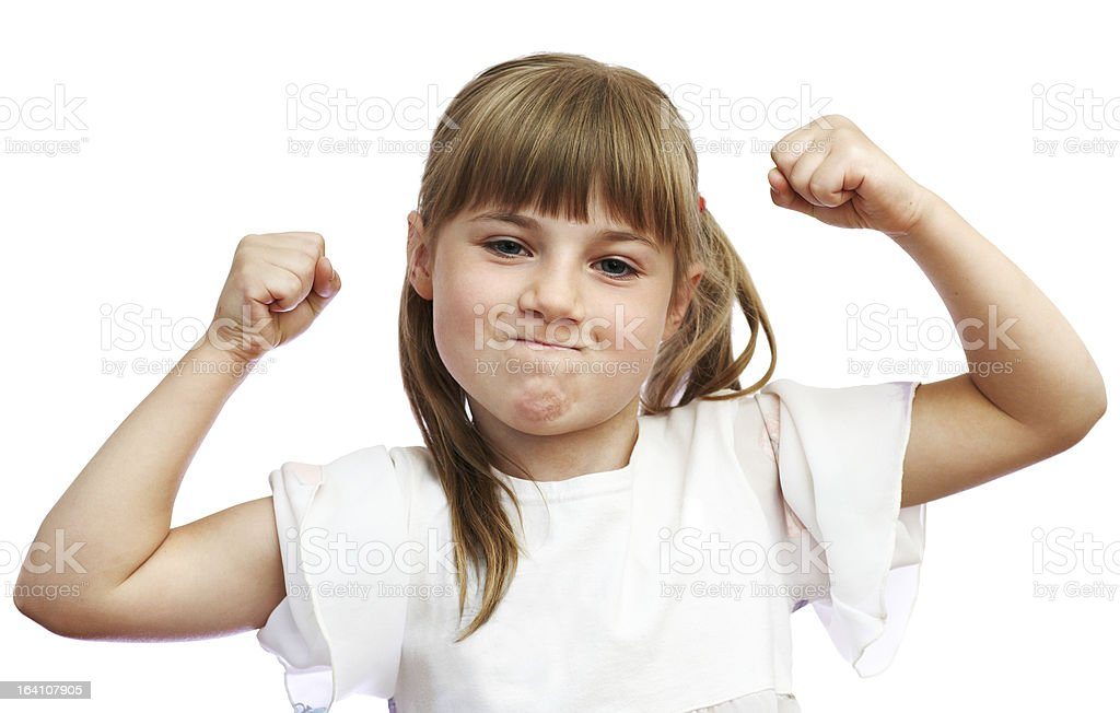 The girl shows that she is strong stock photo