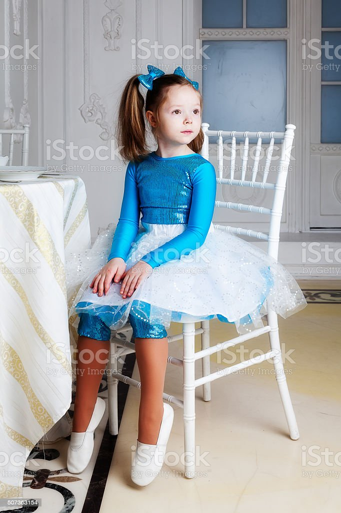 The girl sitting at the table stock photo