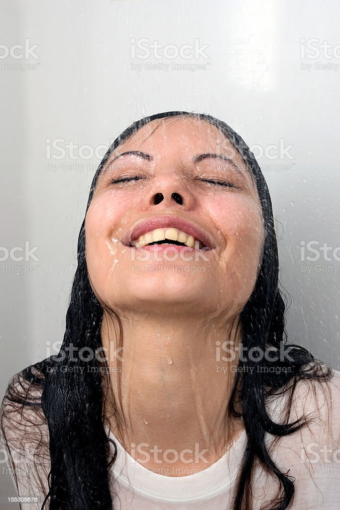 The girl take a shower royalty-free stock photo