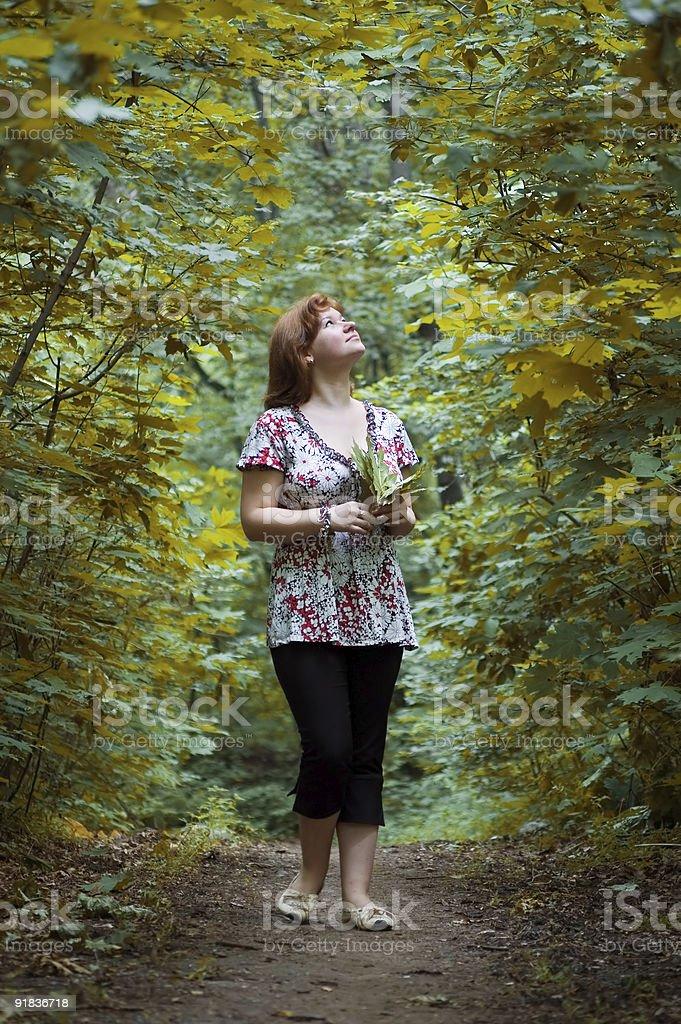 The girl walks on maple avenue royalty-free stock photo
