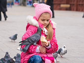 The girl was frightened brazen pigeon who jumped into