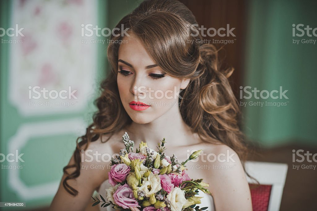 The girl with a bunch of flowers 2671. stock photo
