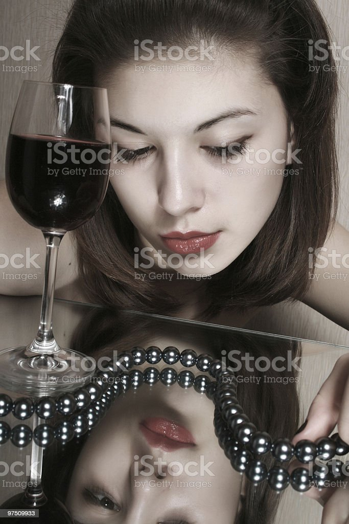 The girl with a glass of wine. royalty-free stock photo