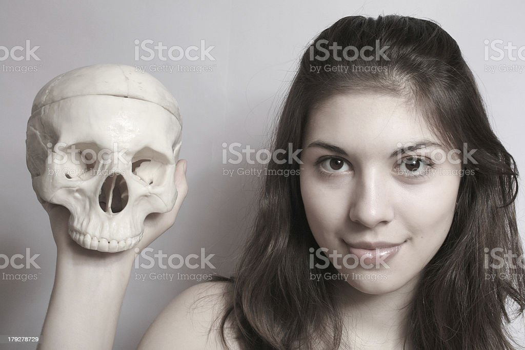 The girl with a skull. royalty-free stock photo