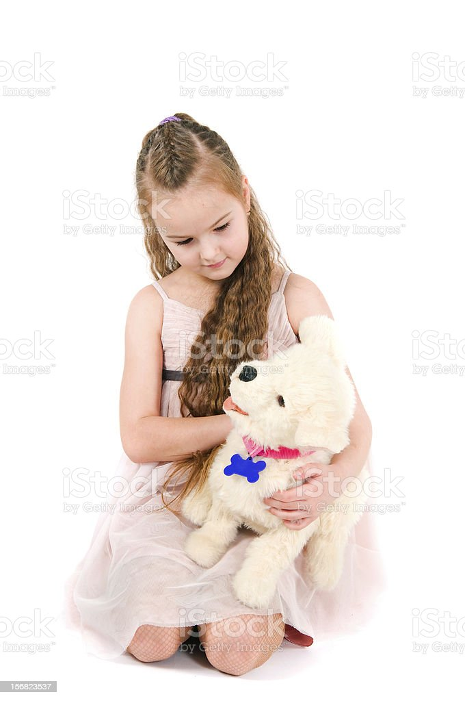 The girl with a toy puppy royalty-free stock photo