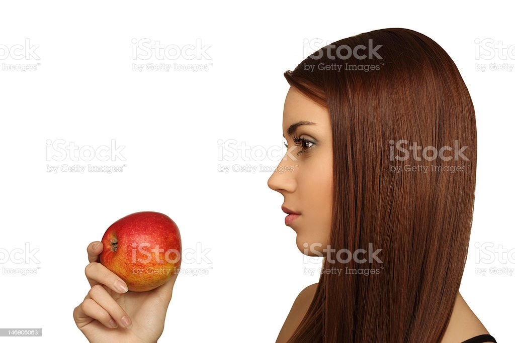 The girl with an apple royalty-free stock photo