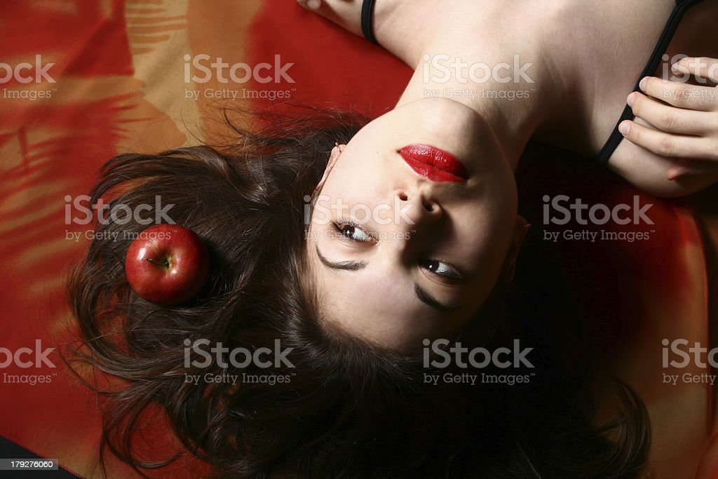 The girl with an apple. royalty-free stock photo