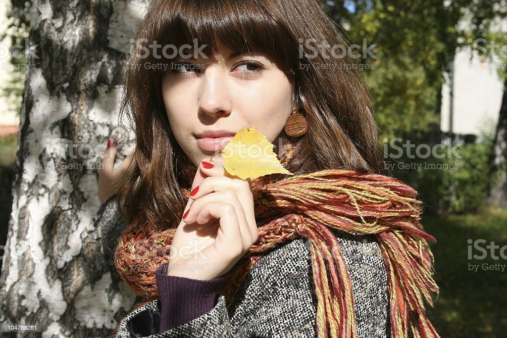 The girl with an autumn leaf. royalty-free stock photo