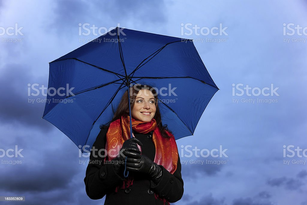 The girl with an umbrella royalty-free stock photo