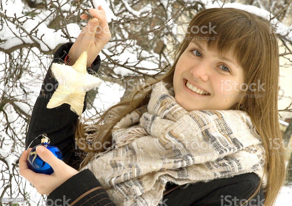 The girl with Christmas ornaments royalty-free stock photo