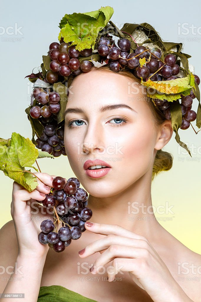 The girl with grapes royalty-free stock photo