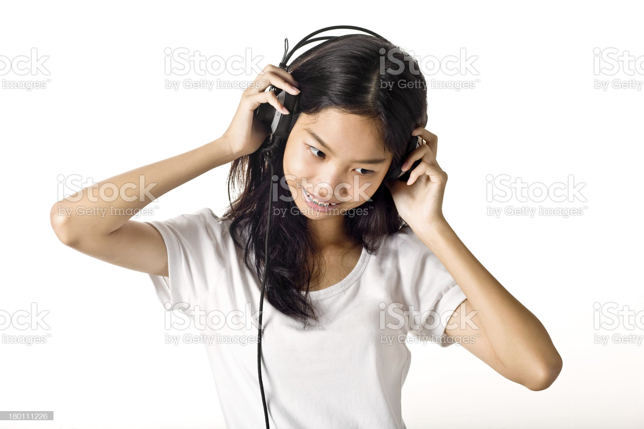 The girl with headphones royalty-free stock photo
