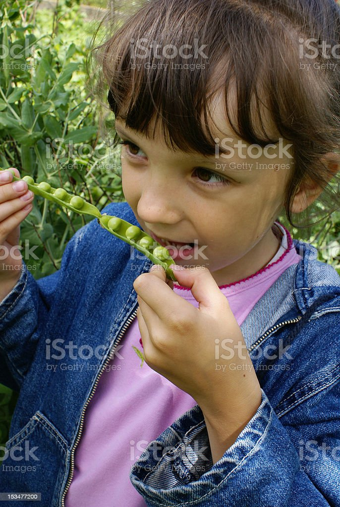 The girl with peas royalty-free stock photo