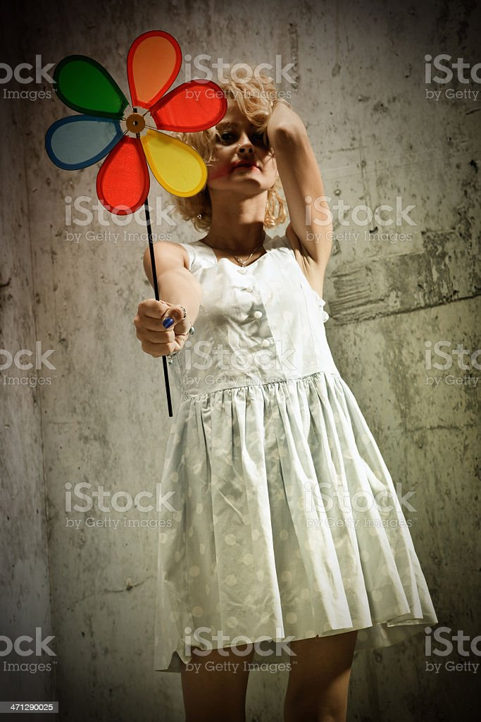 The Girl With Wind Turbine stock photo