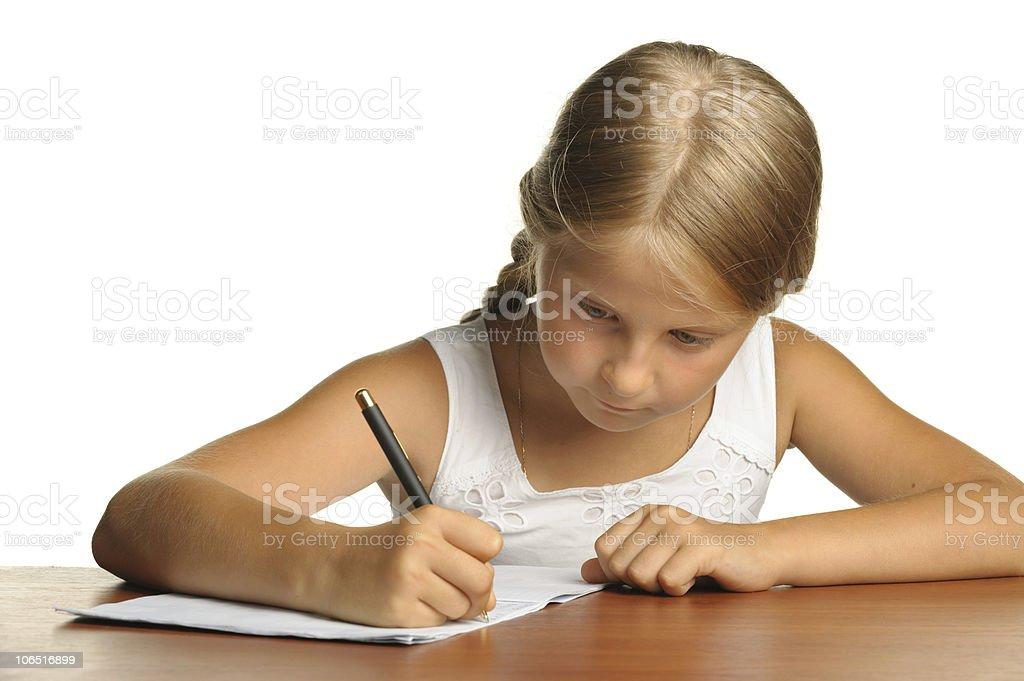The girl writes to writing-books royalty-free stock photo