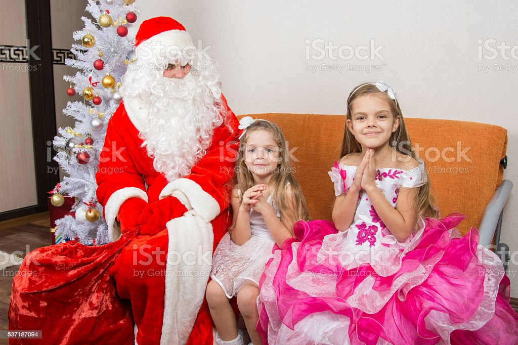 The girls are asking for frost grandfather to give them stock photo