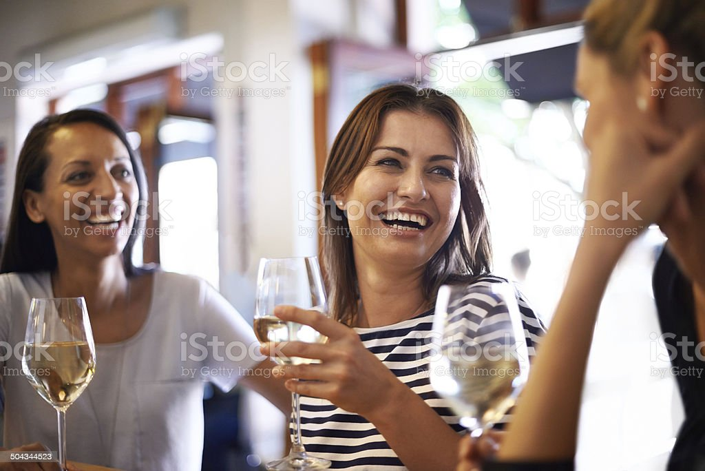 The girls celebrating with a glass of wine stock photo