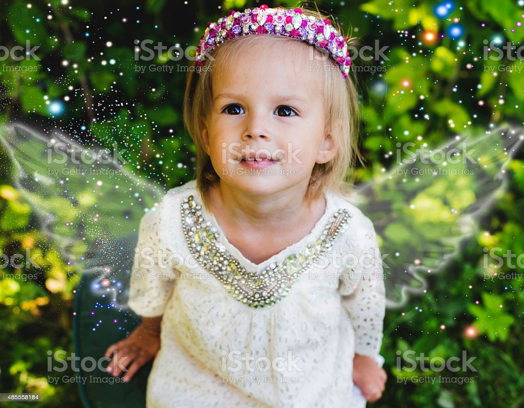 The girl's portrait in brightly pink headband stock photo