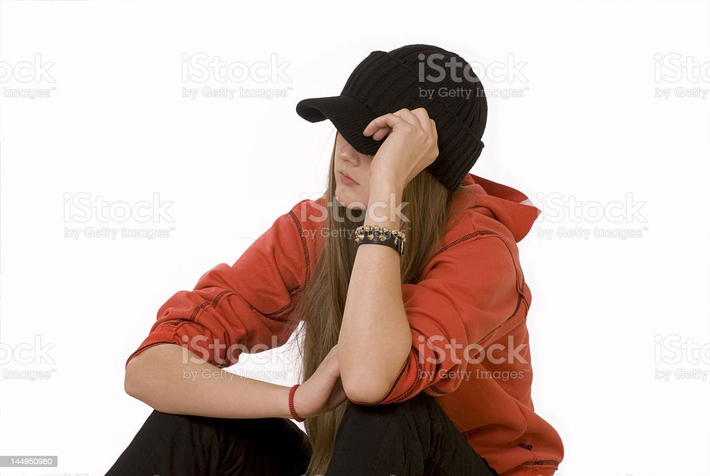 The girl-teenager in a black cap royalty-free stock photo