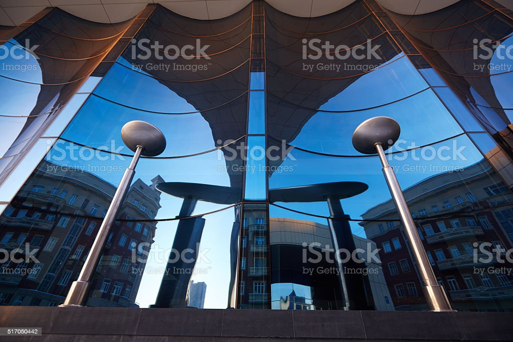 The glass facade of curved blue glass stock photo