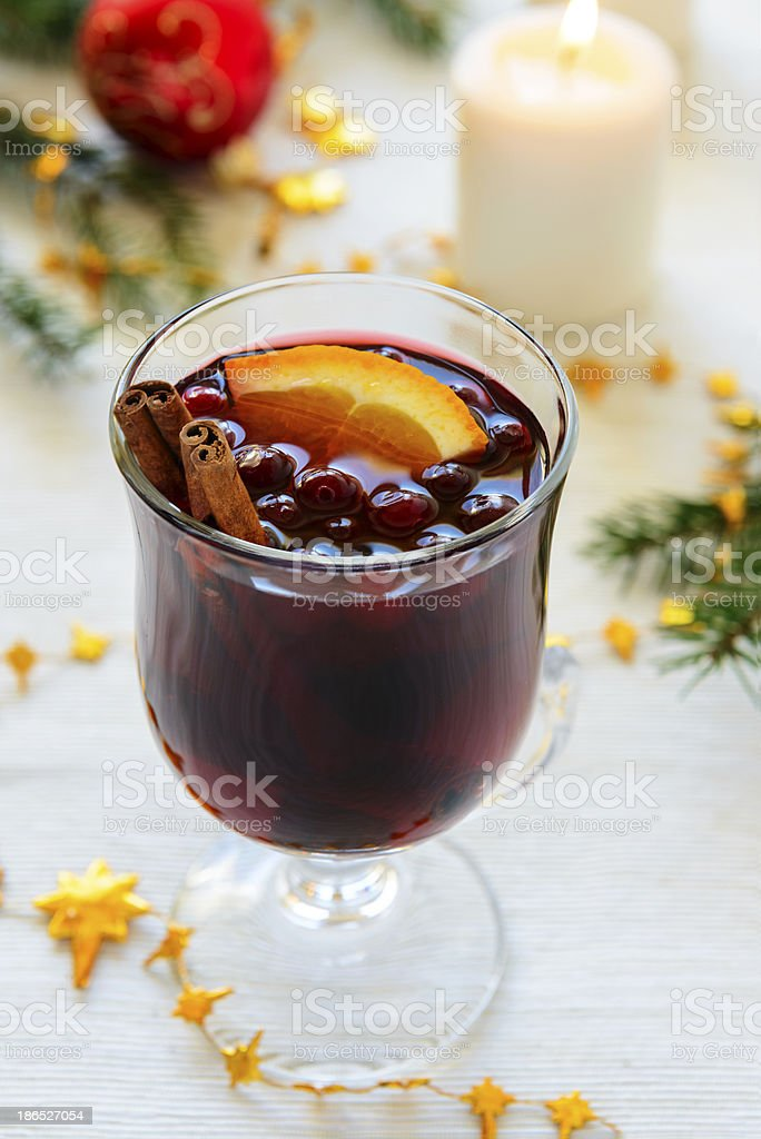 The glass of mulled wine with cranberries and orange royalty-free stock photo