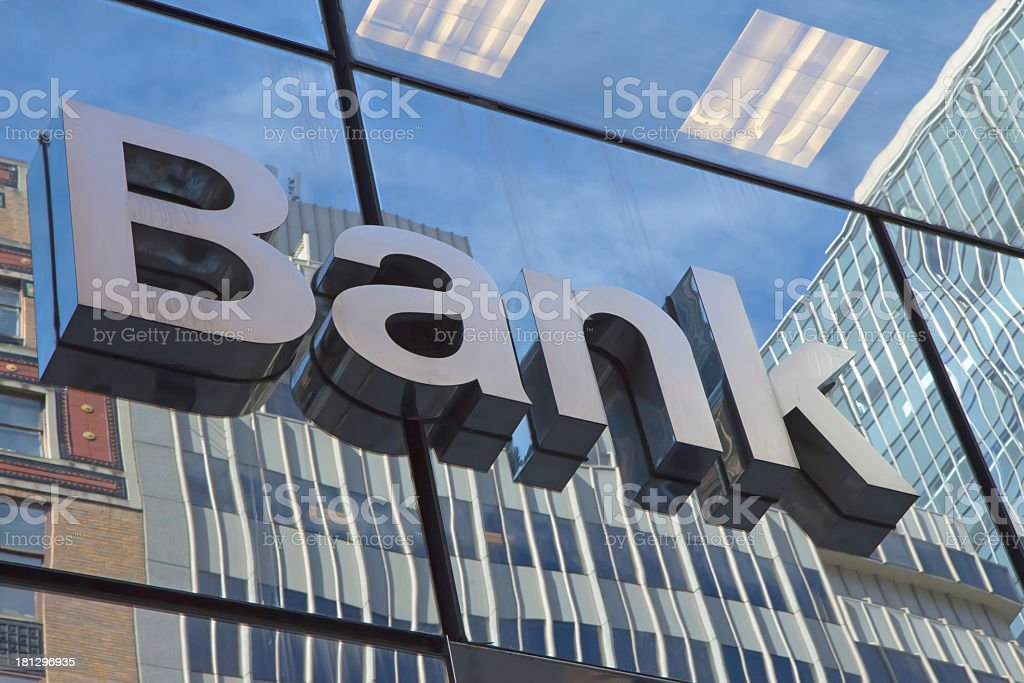 The glass wall with a inscription Bank stock photo