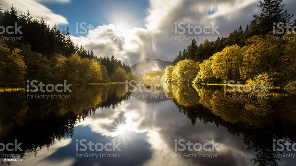 The Glencoe Lochan with a clear reflection in autumn stock photo