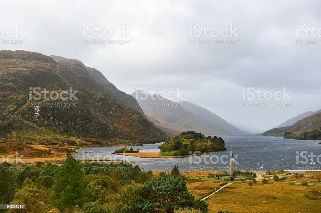The Glenfinnan monument and Loch Shiel on an overcast day stock photo