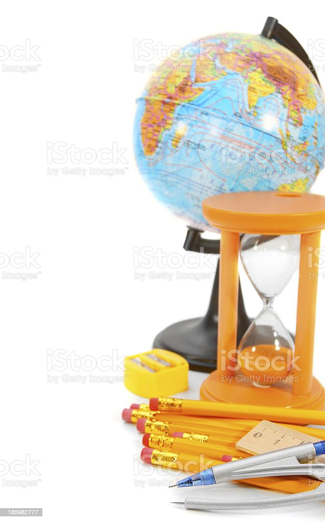The globe, sand-glass and school subjects on a white background royalty-free stock photo