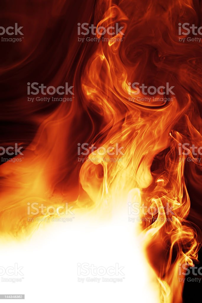 The glowing flames of a roaring fire stock photo