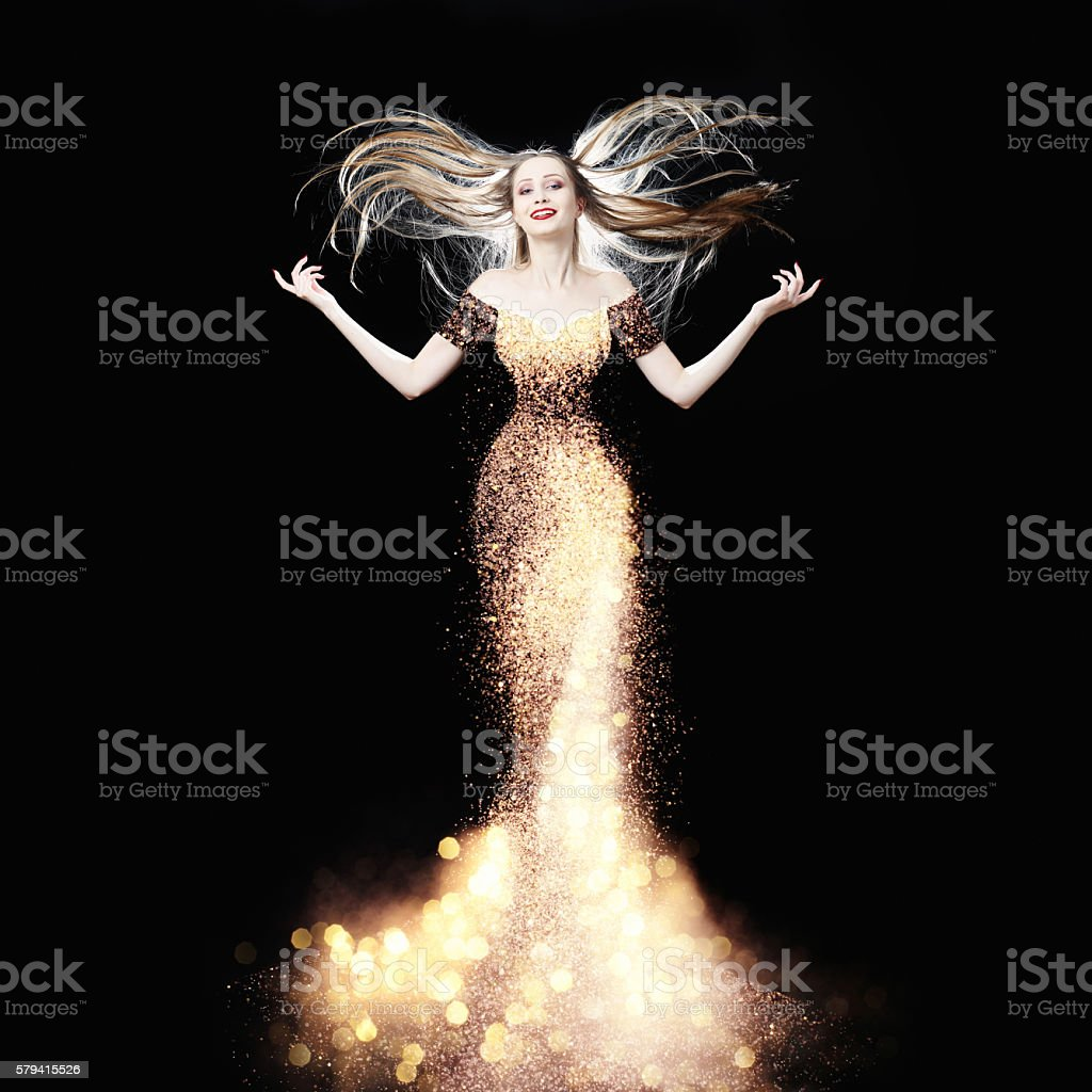 The glowing star in haute couture dress stock photo
