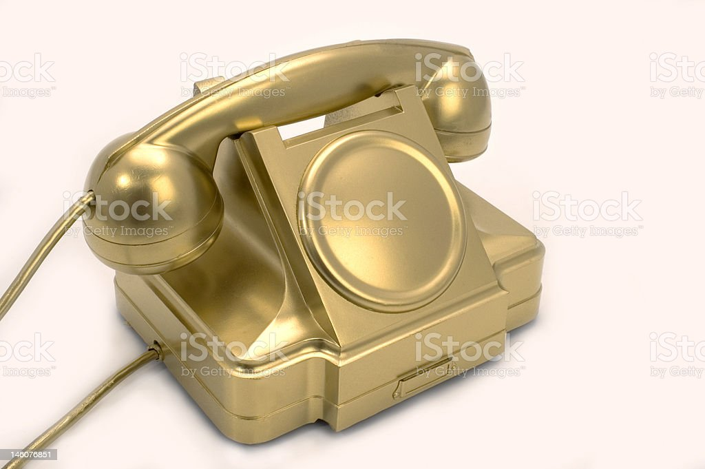 The gold telephone. royalty-free stock photo