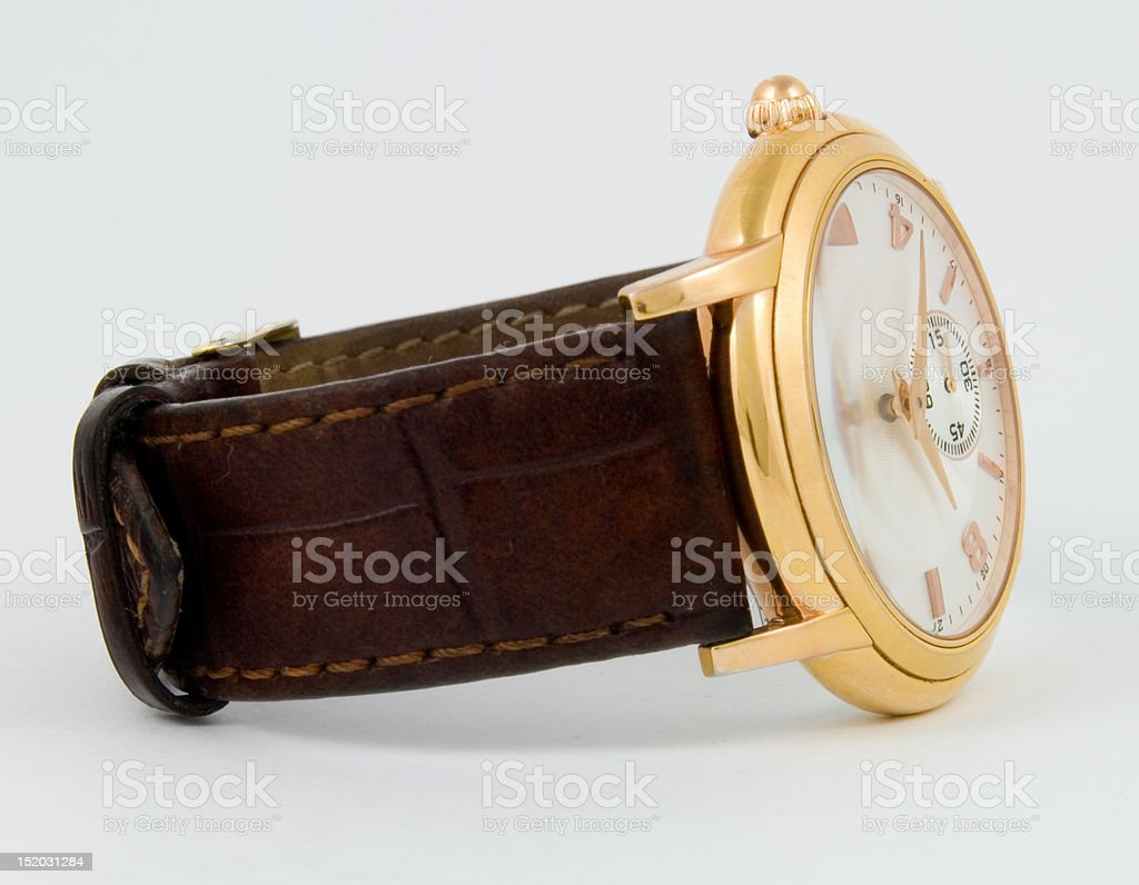 The gold wristwatch stock photo