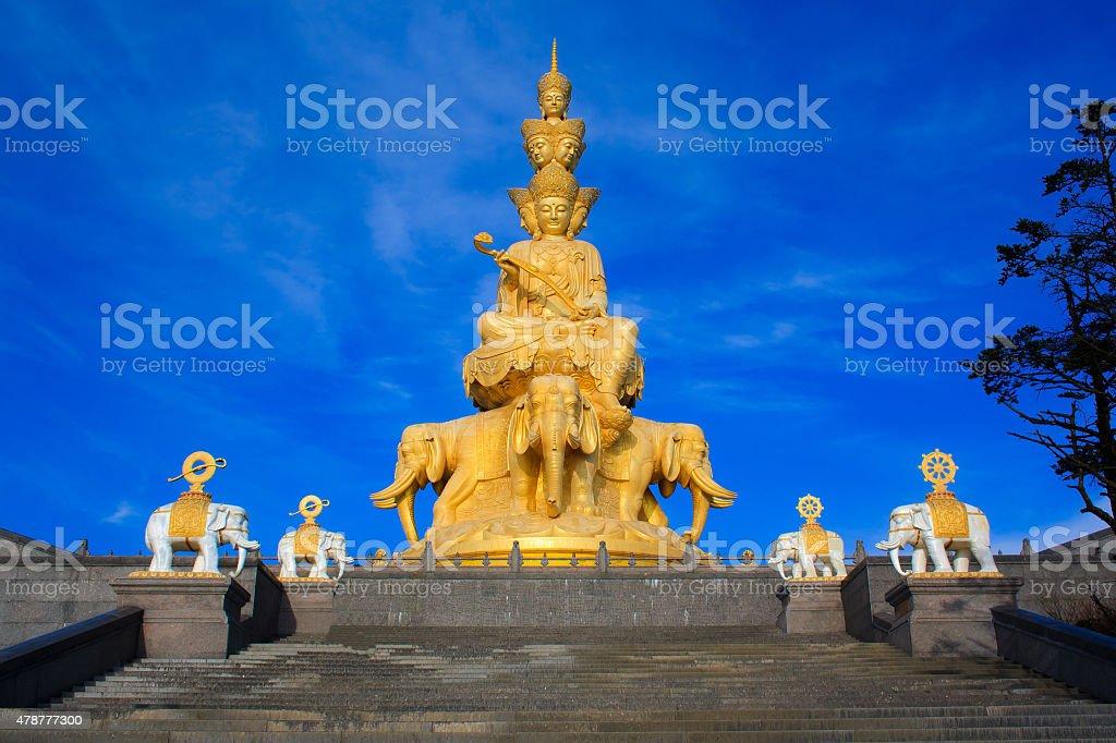 The golden buddha of Emeishan peak. stock photo
