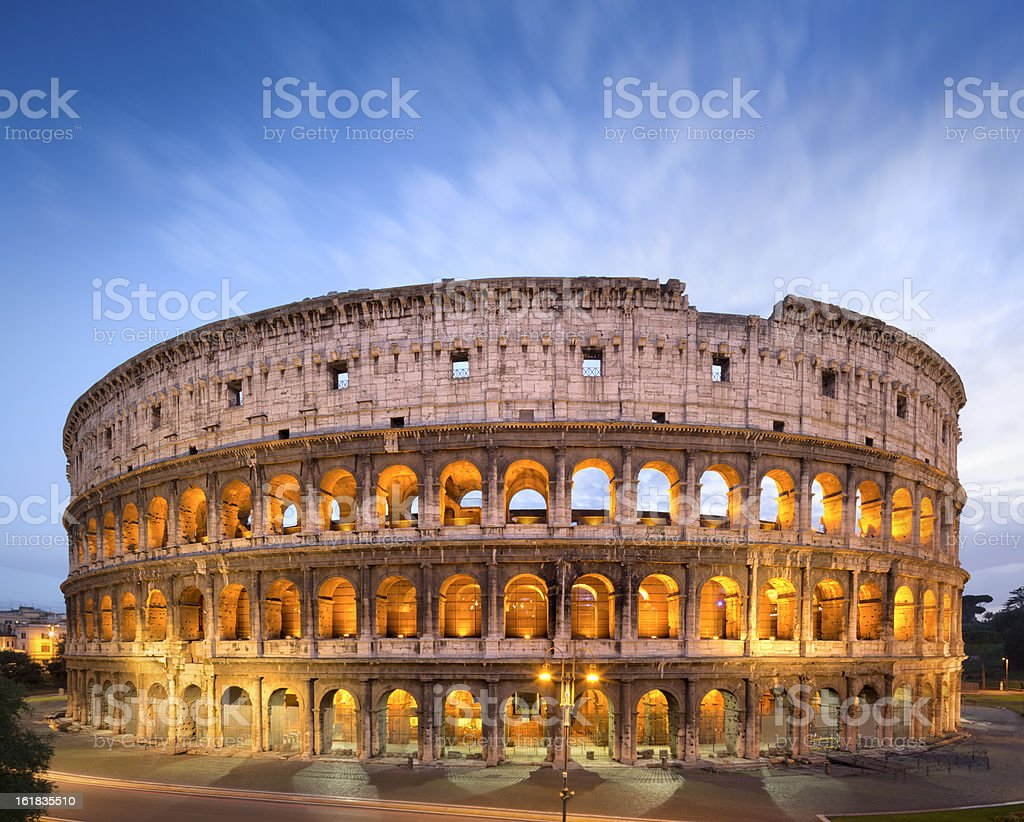 The Golden Colosseum at dusk in Rome, Italy  stock photo