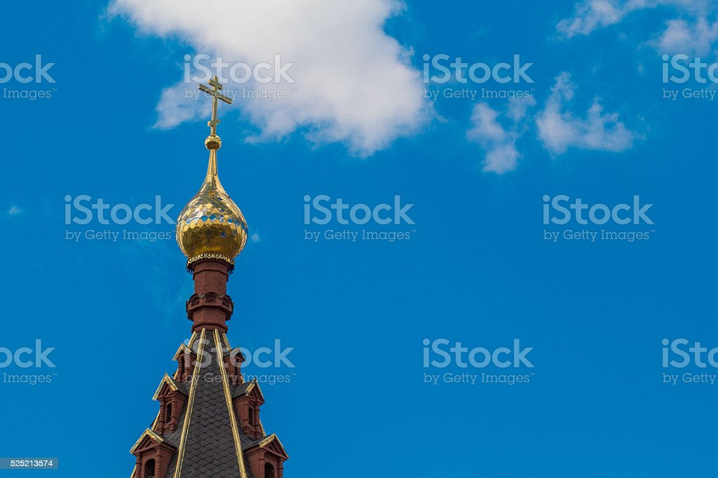 The Golden dome of the temple on blue sky background royalty-free stock photo