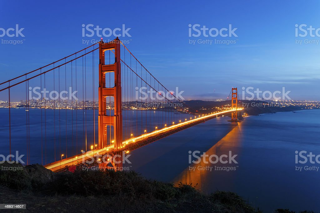 The Golden Gate Bridge at night all lit up stock photo