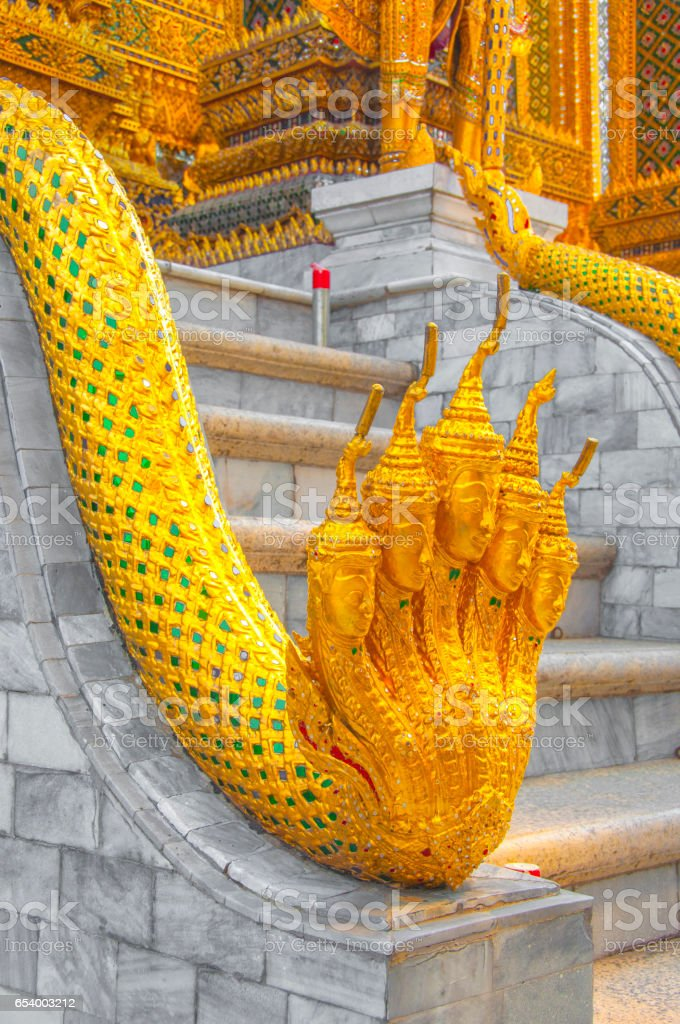 The Golden  Naga statue at Wat Phra Kaew, Royal Grand Palace, Bangkok, Thailand. stock photo