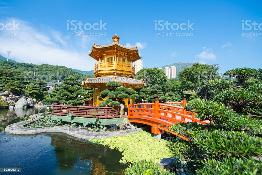 The golden pavilion and red bridge at Nan Lian garden stock photo