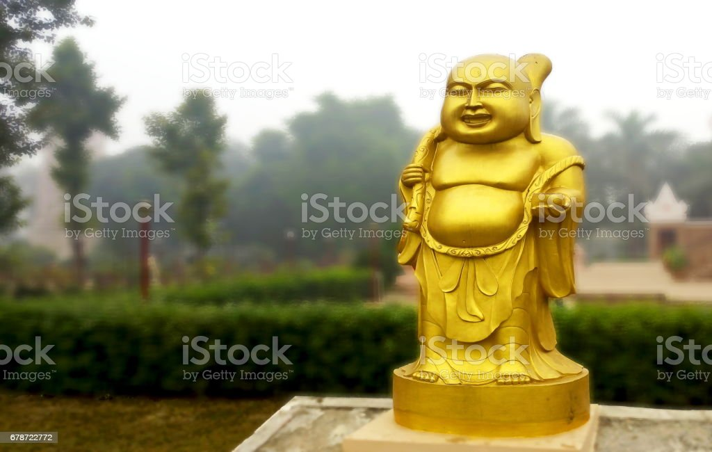 The golden statue of Laughing Buddha at Sarnath, near Varanasi, India stock photo
