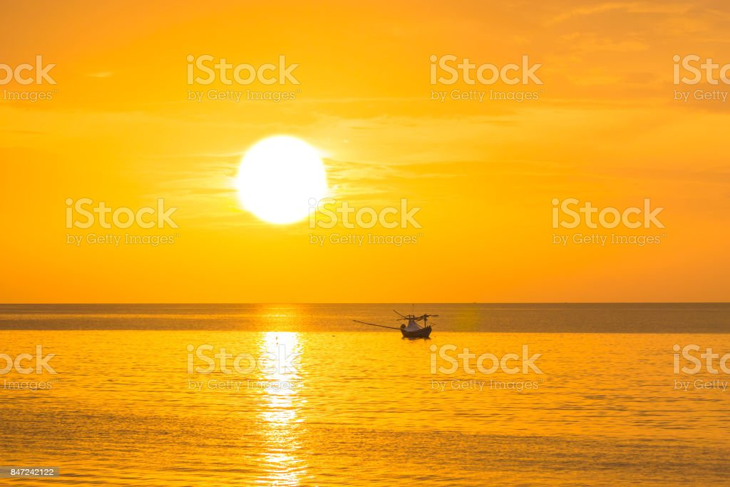 The golden sun in the morning of a new day on the sea in the Gulf of Thailand stock photo
