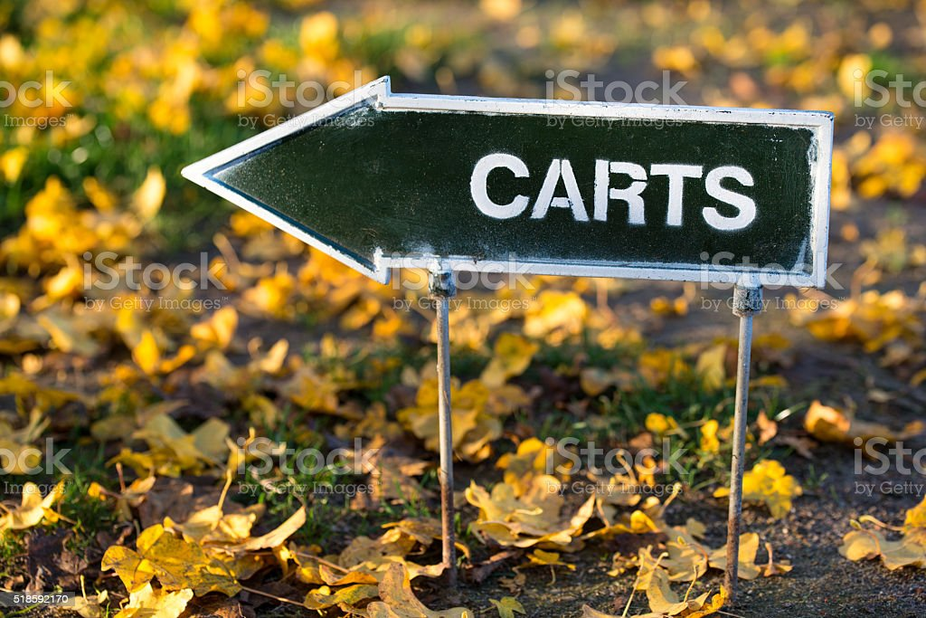 The golf carts direction sign on autumn golf field stock photo