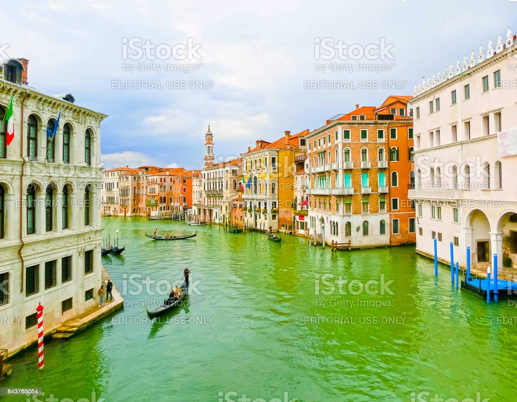 The gondola sails down the channel in Venice, Italy. Gondola is a traditional transport in Venice, Italy stock photo