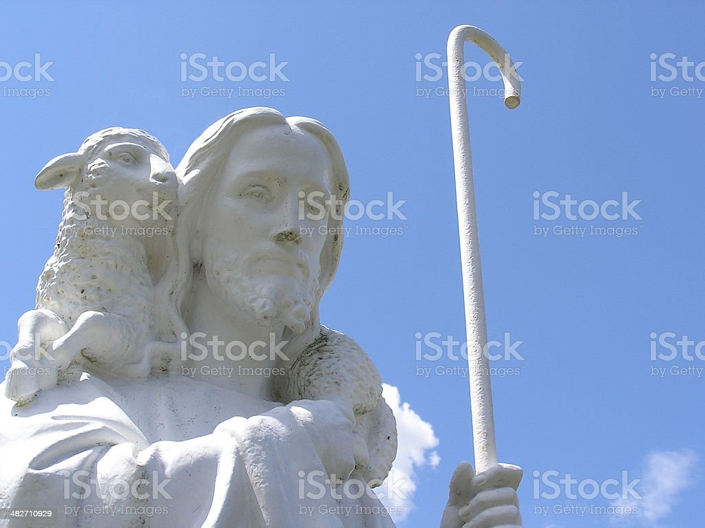 The Good Shepherd – front view - a cemetery statue stock photo