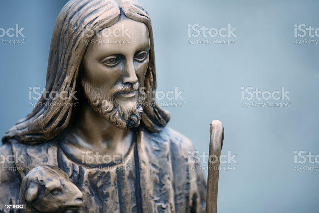 The good shepherd: Jesus statue with lamb royalty-free stock photo
