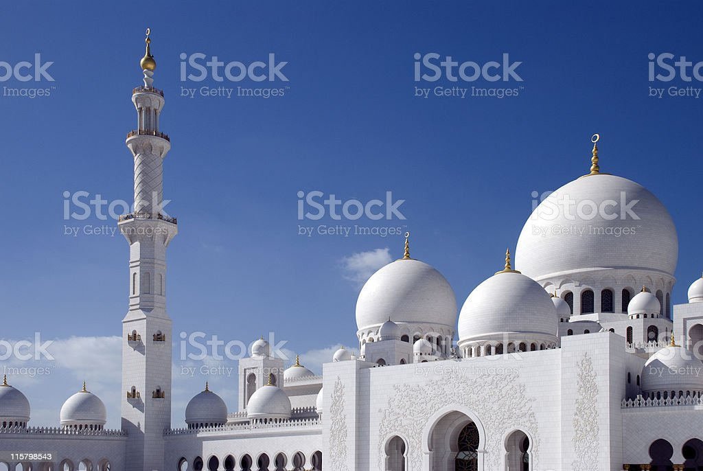 The Grand Mosque in Abu Dhabi with beautiful blue sky stock photo
