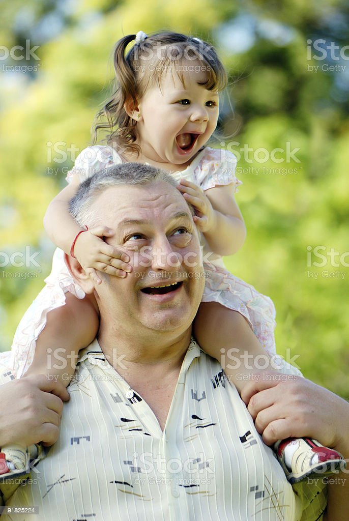 The grandfather with grand daughter in park royalty-free stock photo