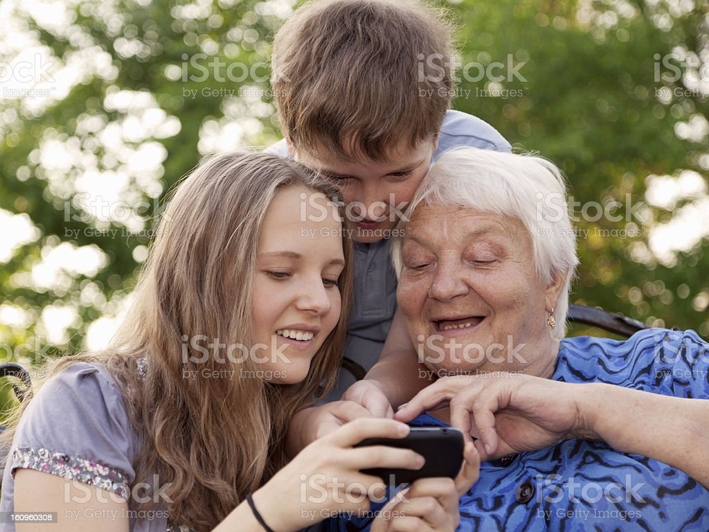 The grandmother and grandsons on walk royalty-free stock photo