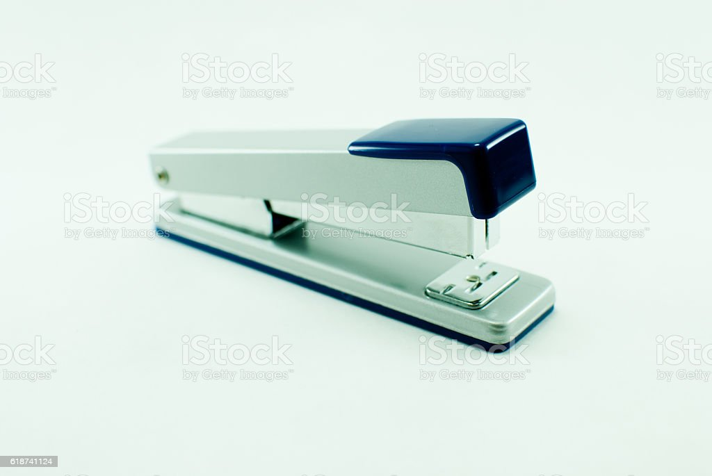 The gray-blue stapler on the white background. Isolated stock photo